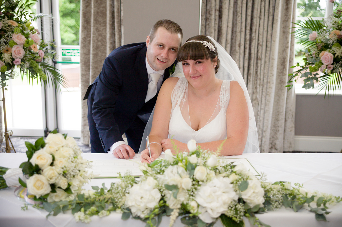 Wedding photography - signing of the wedding certificate